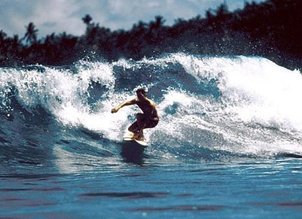 Go surfing on a sailing break in Tonga