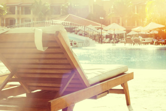 Sunbathing chair at a resort pool, instagram style
