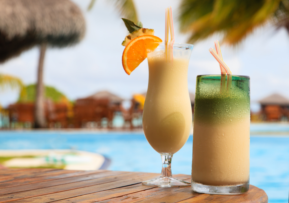 Two exotic cocktails on tropical beach resort